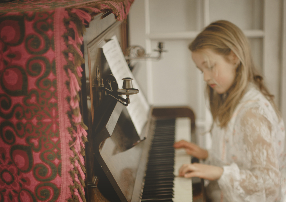 Little girl on piano!
