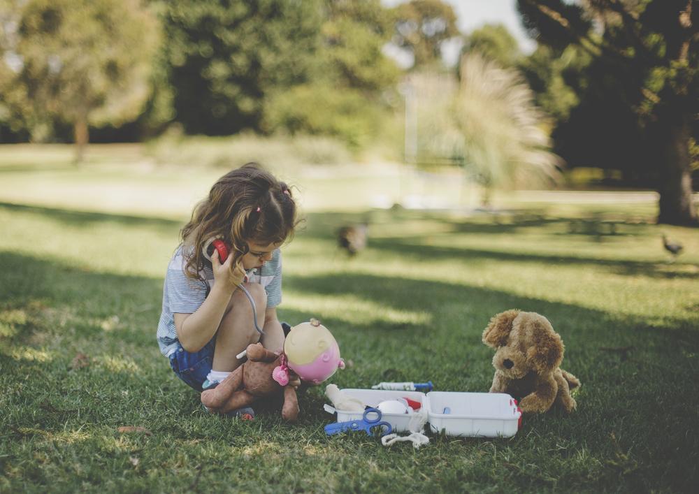 Little girl playing Doctors & Nurses!