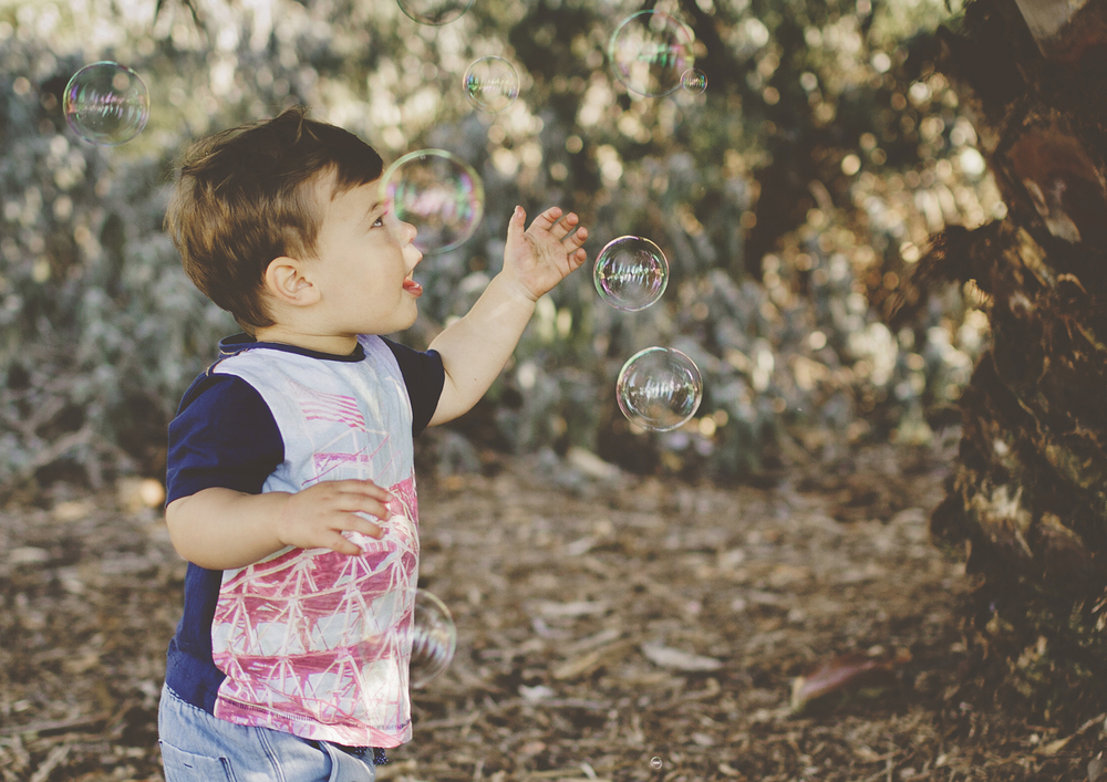 Toddler playing with bubbles!