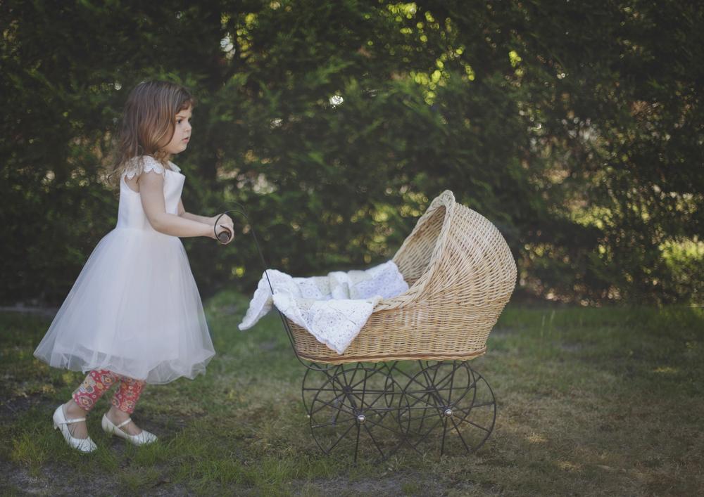 Child walking her toy pram!