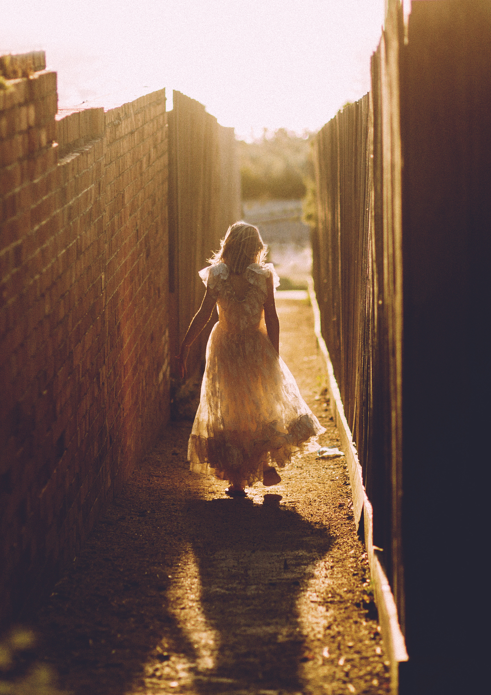 Little girl running down the laneway!