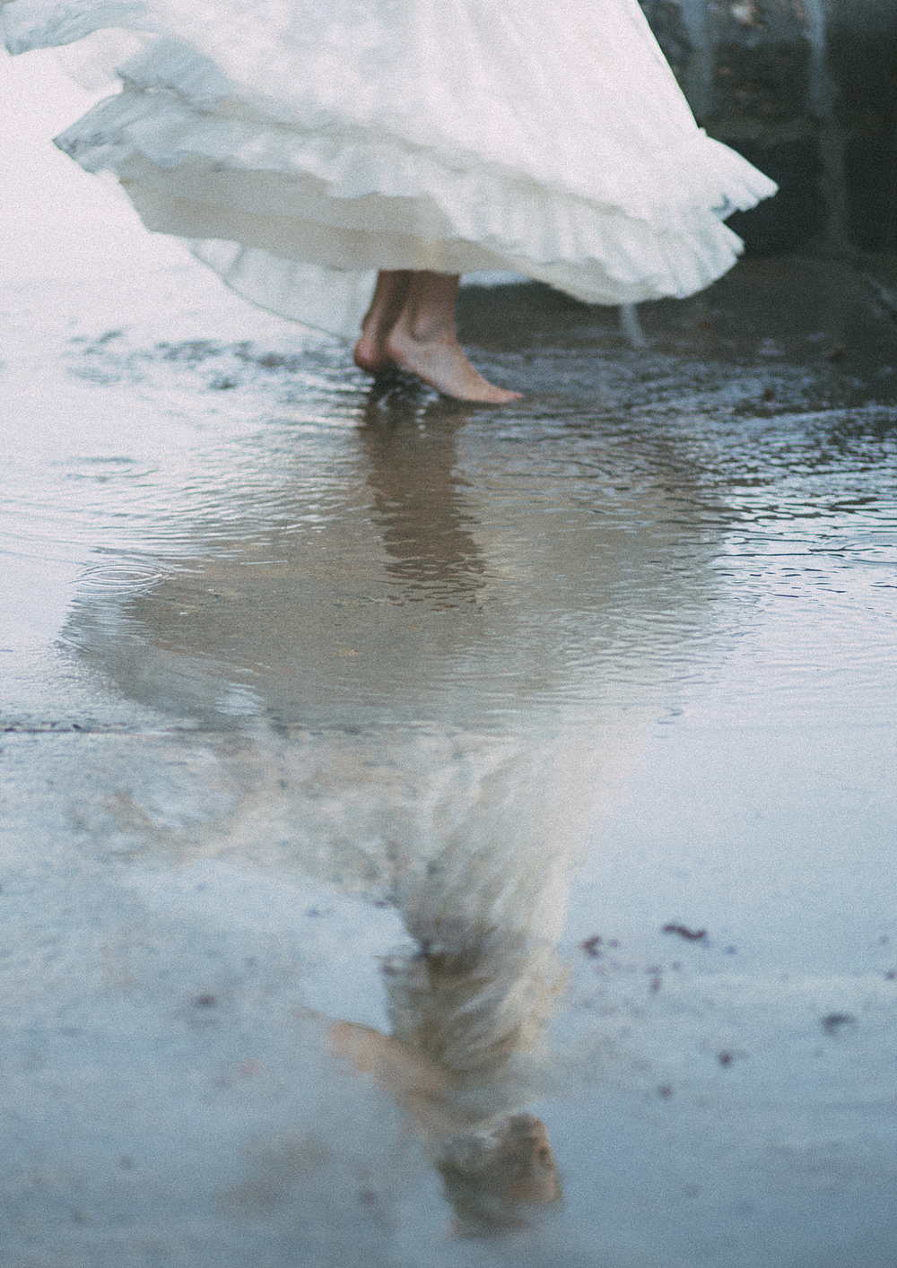 Little girl dancing in the puddle!