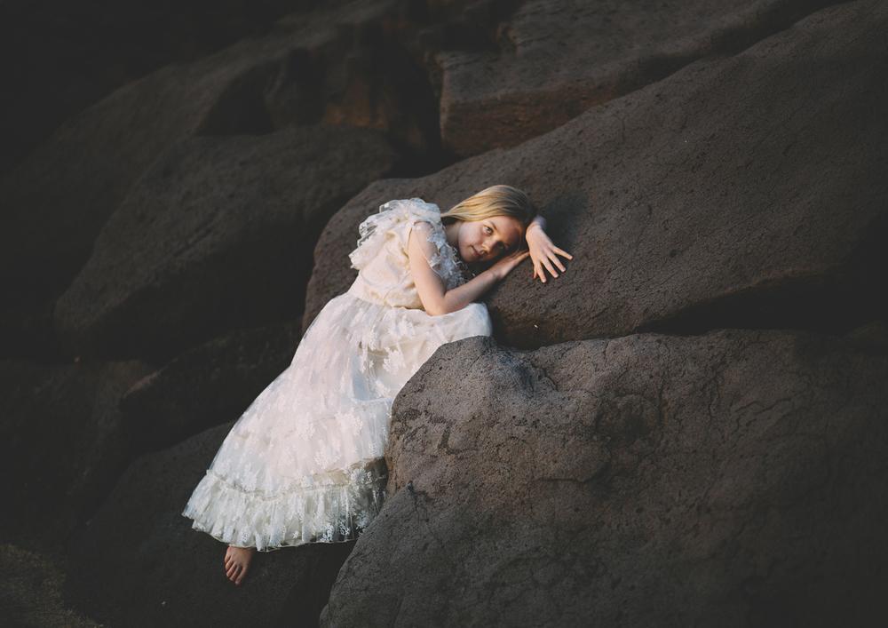 Beautiful girl wearing vintage dress against the rocks!