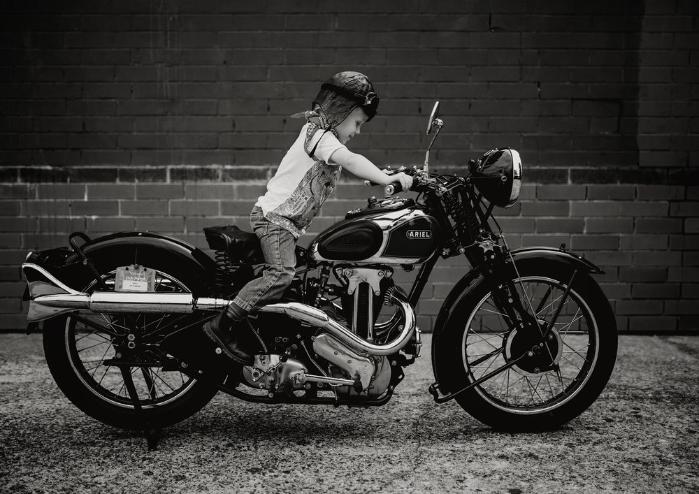 Small child on large vintage motorbike!