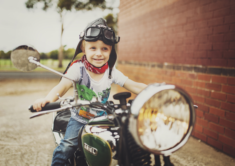 Little boy sitting on vintage motorbike!