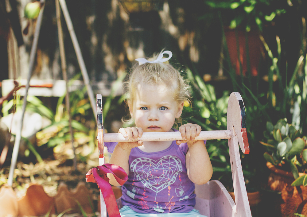 Little toddler on rocking horse - Melbourne Children's Photography