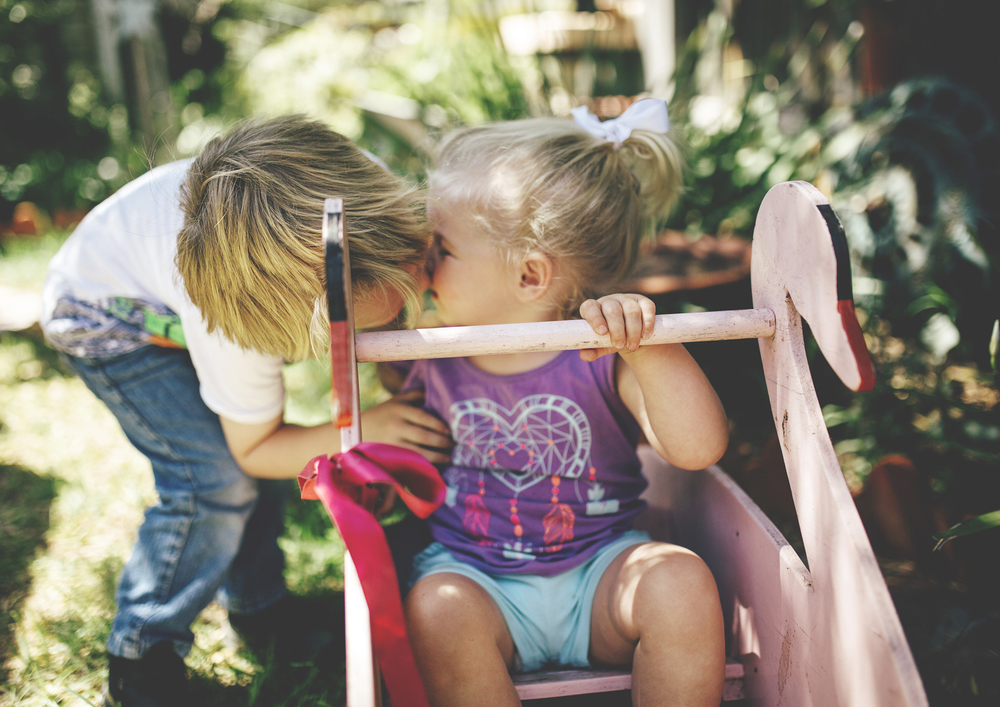 Big brother kissing his little sister | Children Photography Melbourne