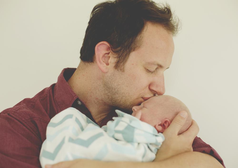 Daddy kissing newborn baby!