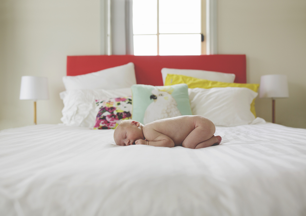 Newborn boy lying on parent's bed - Melbourne Newborn Lifestyle Photography