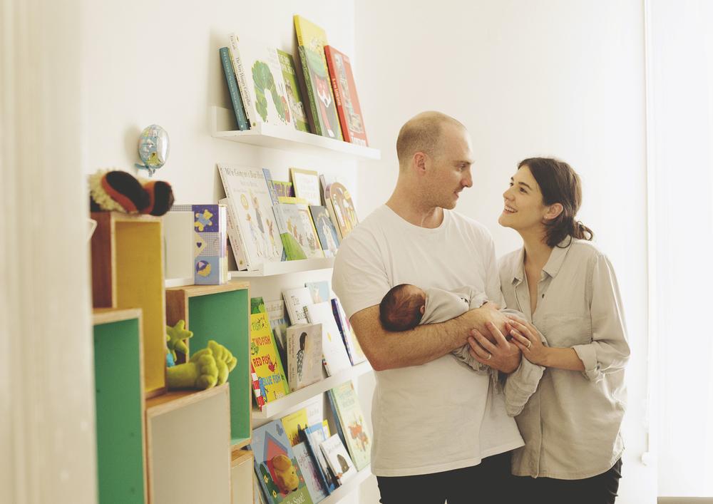Proud Parents holding newborn baby in nursery!