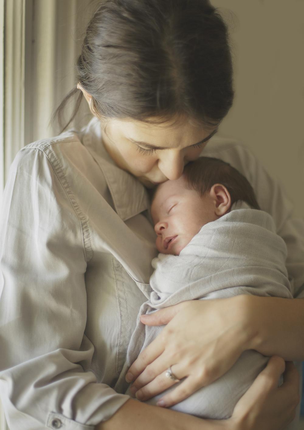 New Mum holding her newborn baby boy!