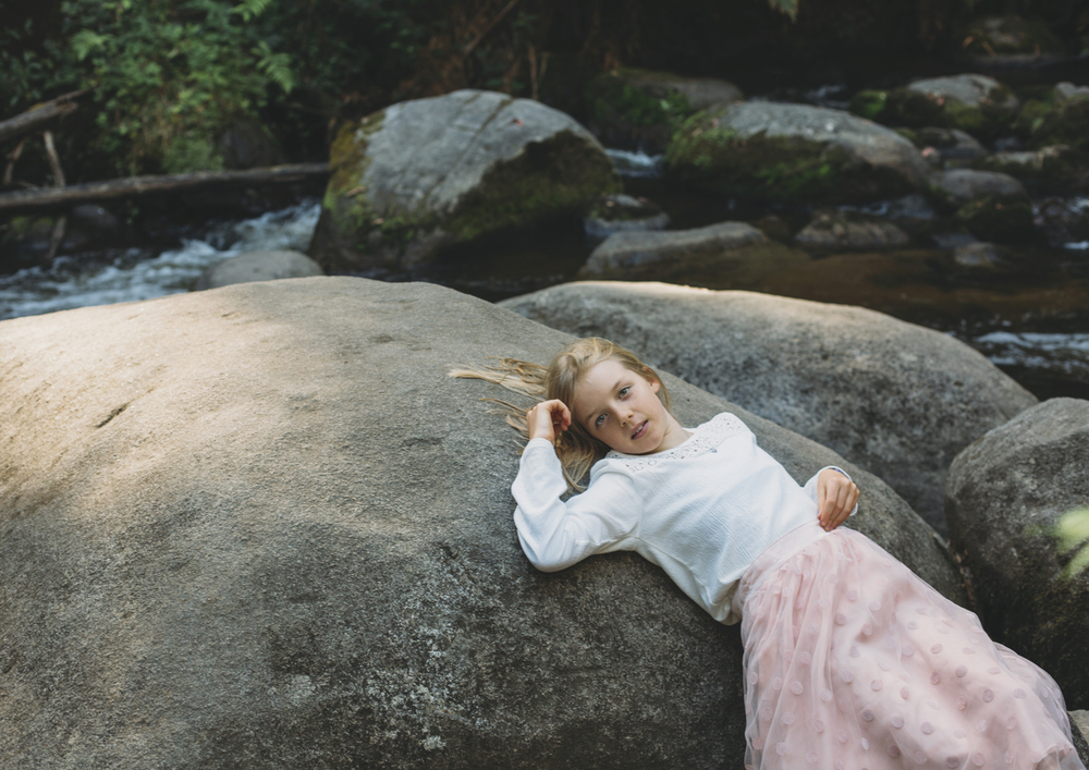 Little girl lying on rock - Famiy Photography