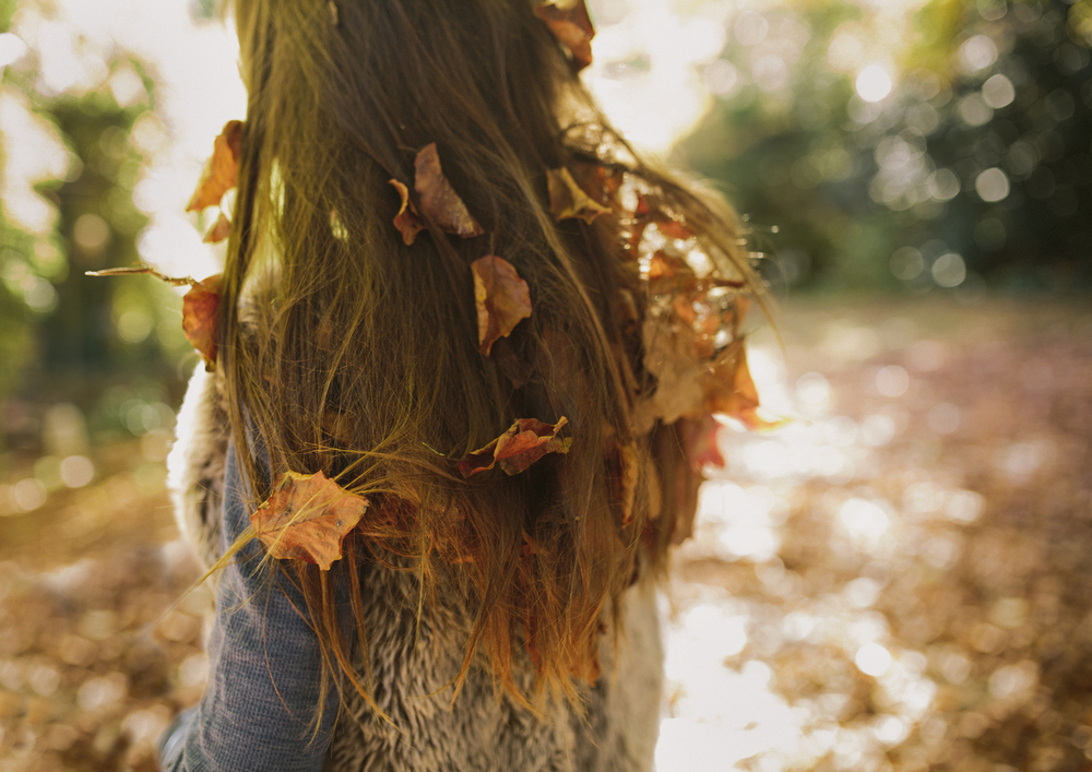 Autumn leaves in child's hair!