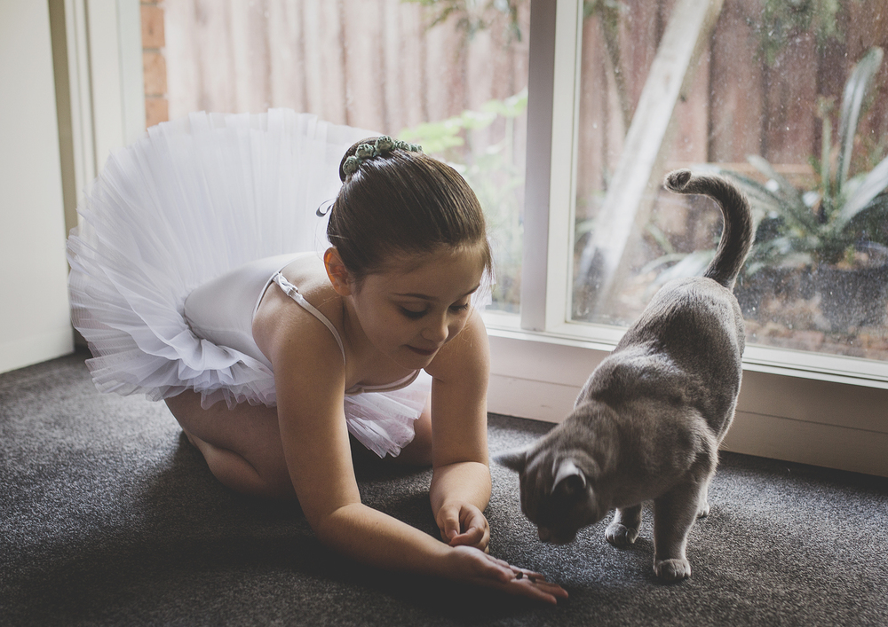 Little girl playing with her cat!