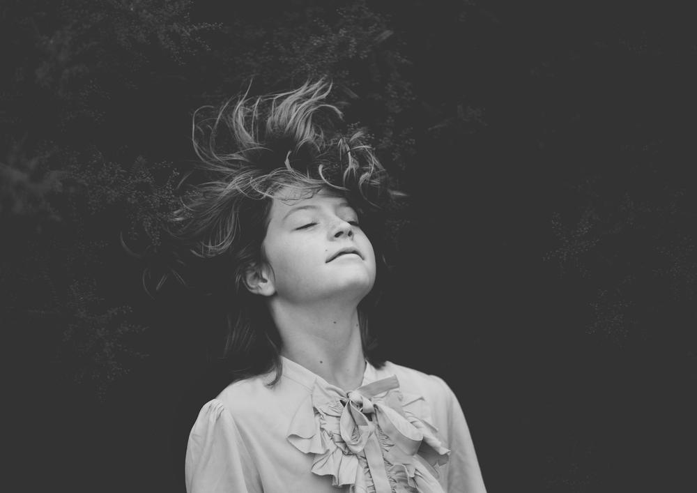 Little girl throwing back her hair!