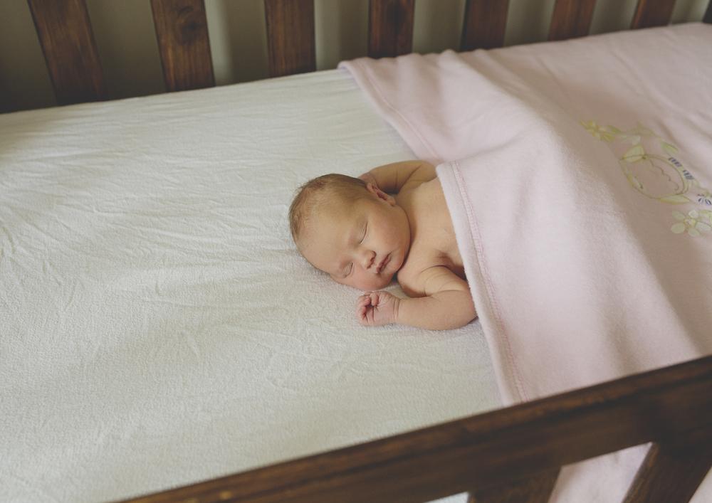 Newborn little girl in her cot!