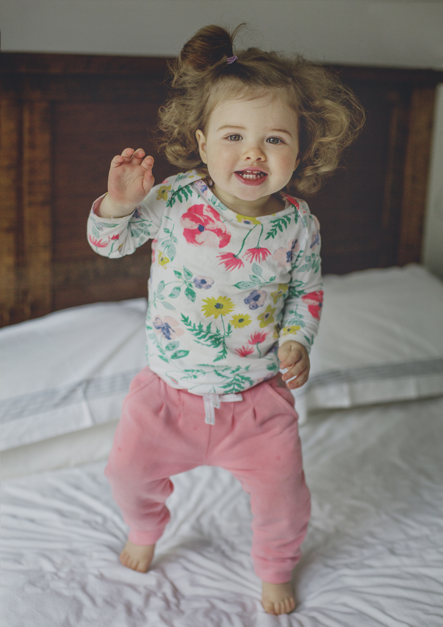 Little toddler jumping on the bed!