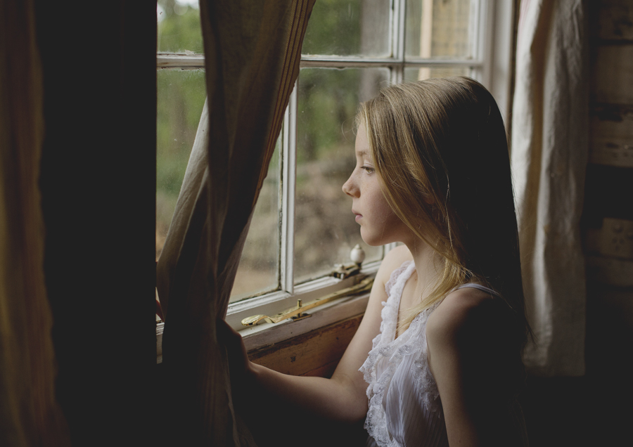 Young tween girl daydreaming out the window!