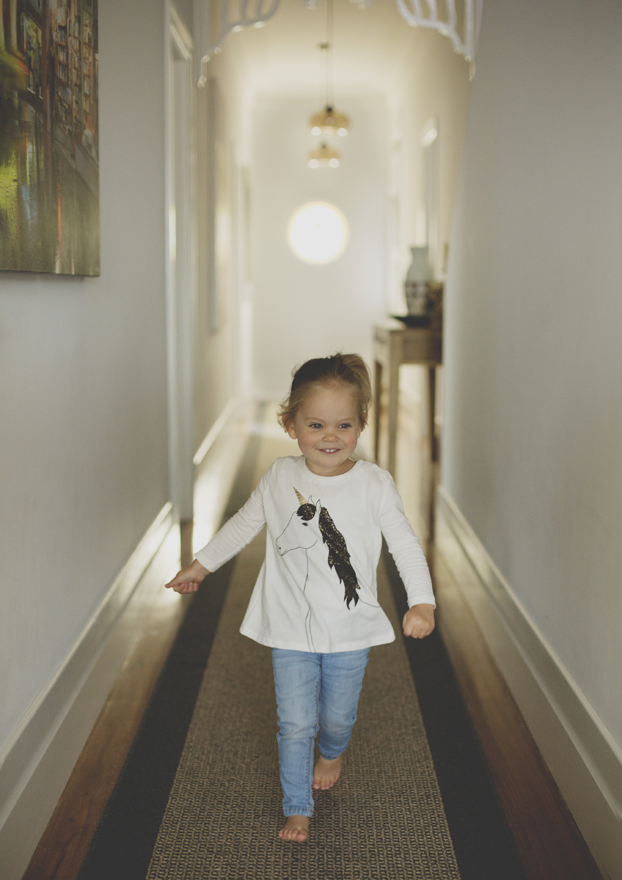Toddler running up the hallway!