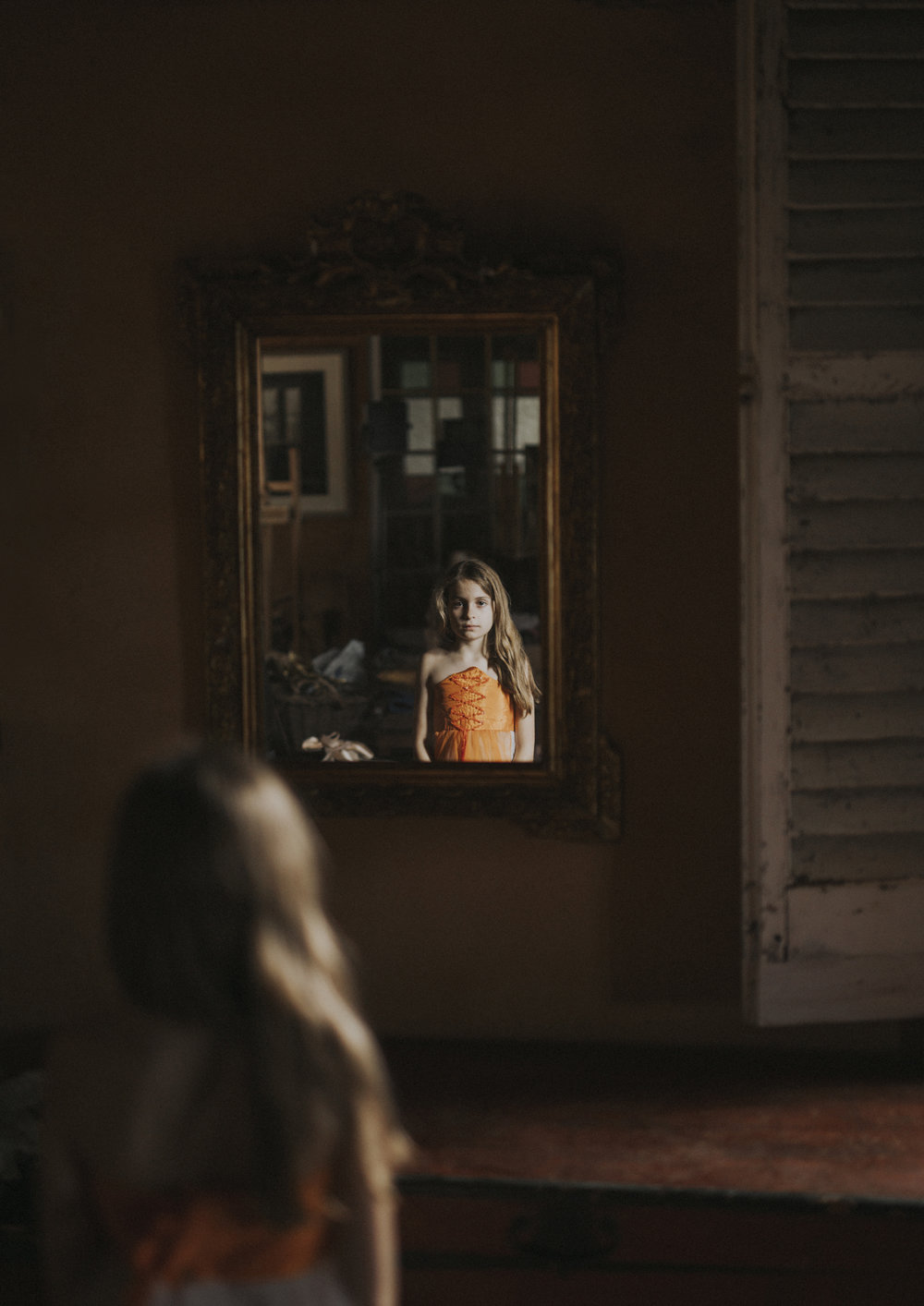 Reflection of Tween girl in mirror