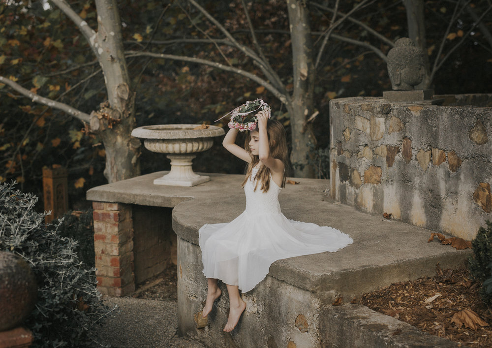 Tween girl in vintage garden