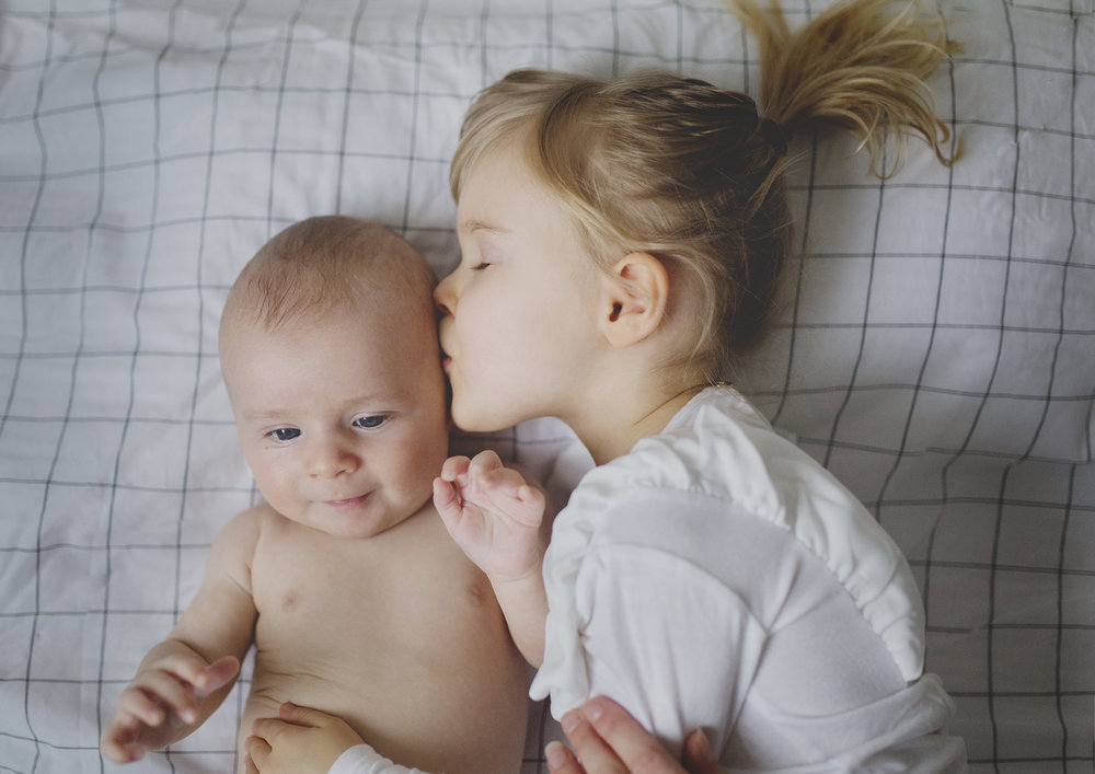 Big Sister kissing her little brother!