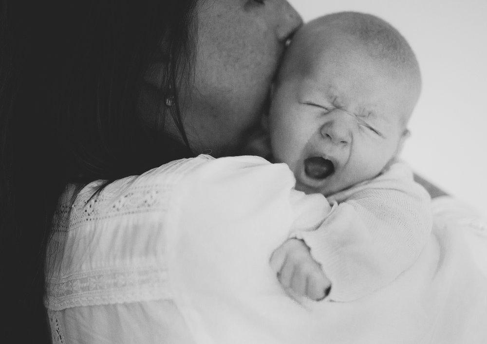 Newborn baby girl's big yawn