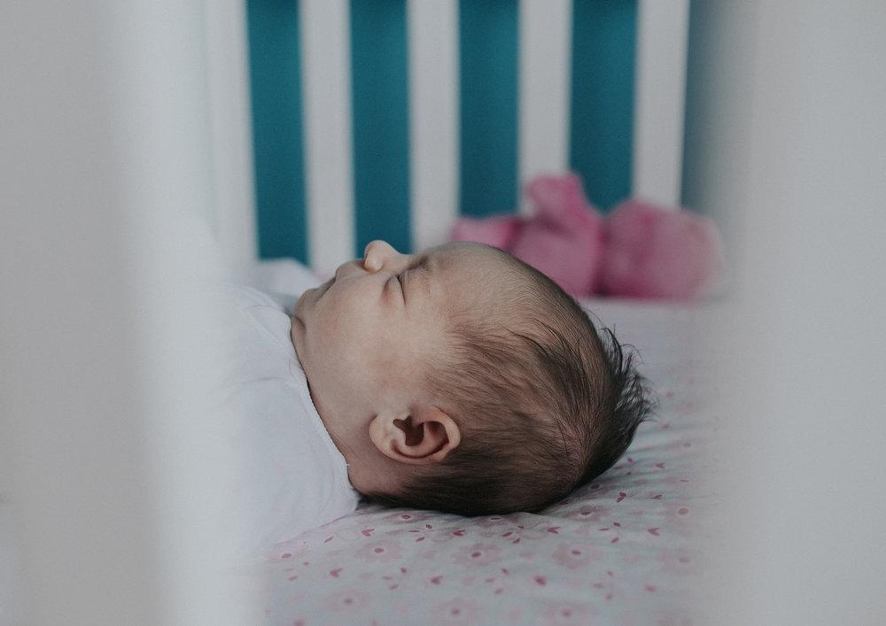 Newborn baby in her cot