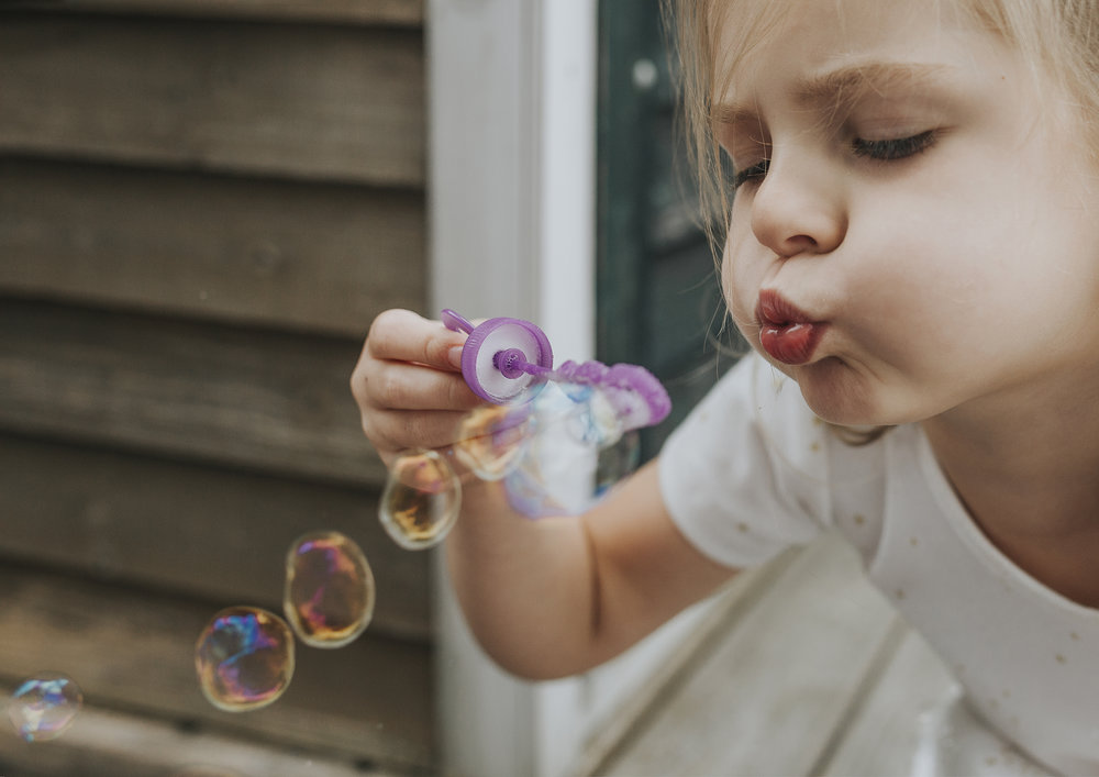 Photo of Child blowing bubbles!