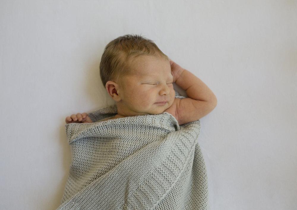 Newborn baby boy smiles!