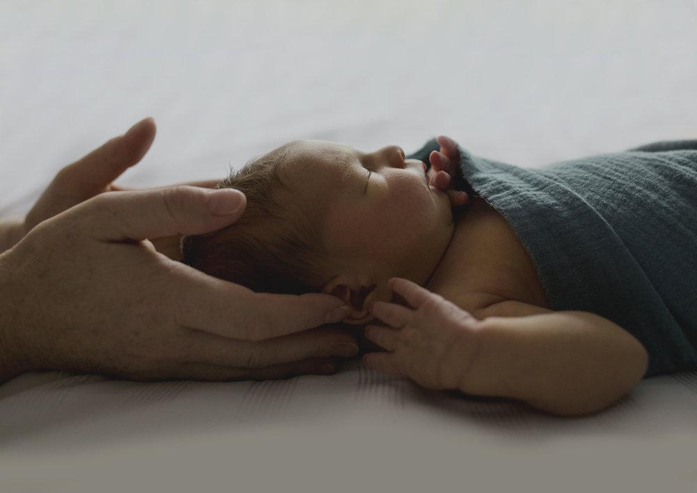 Tiny newborn baby boy