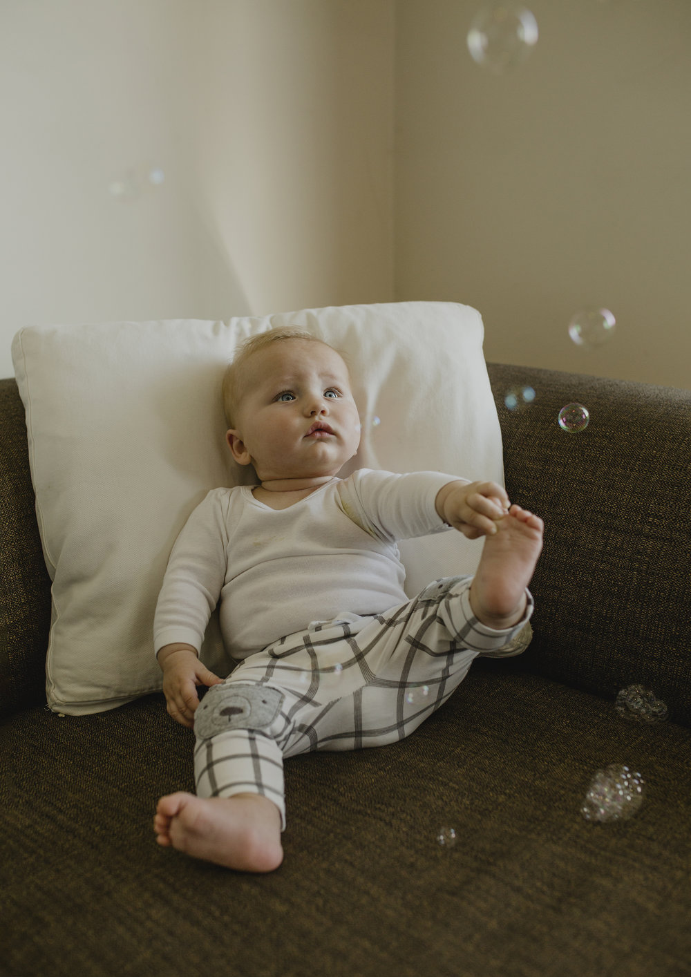 6 month old baby looking at bubbles