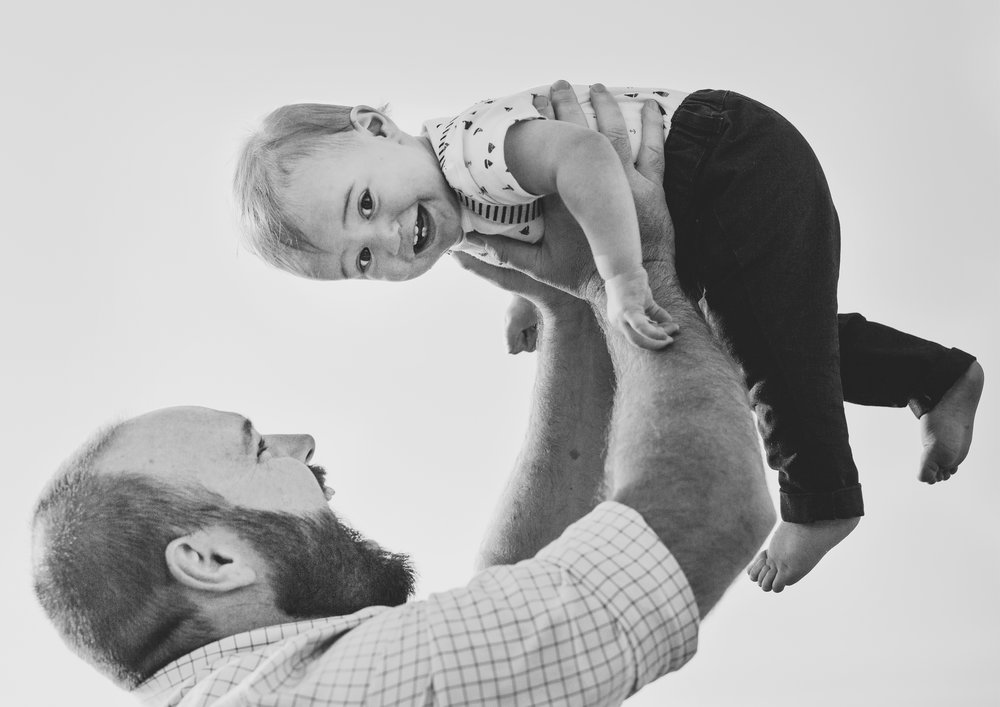 Dad lifting his baby son up!