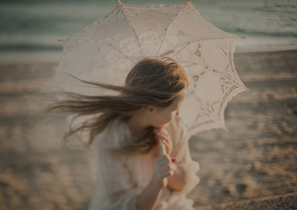 Freelensed image of Tween girl at a styled photo shoot at the beach