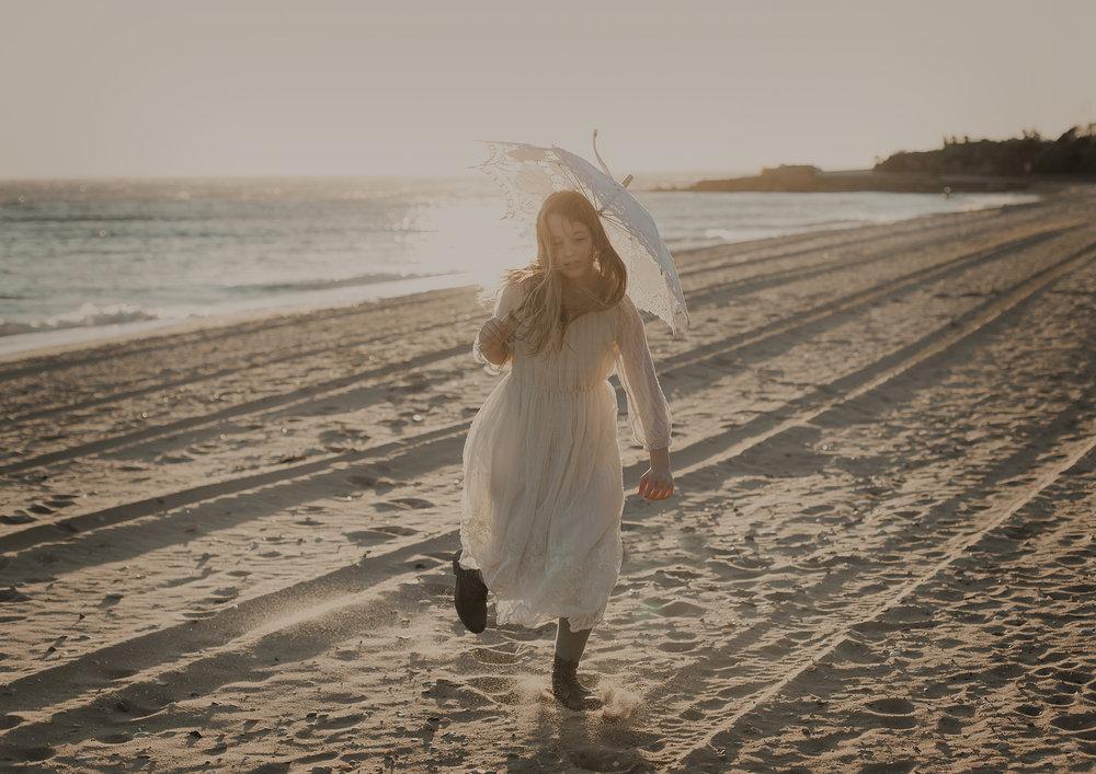 Tween girl running on the beach