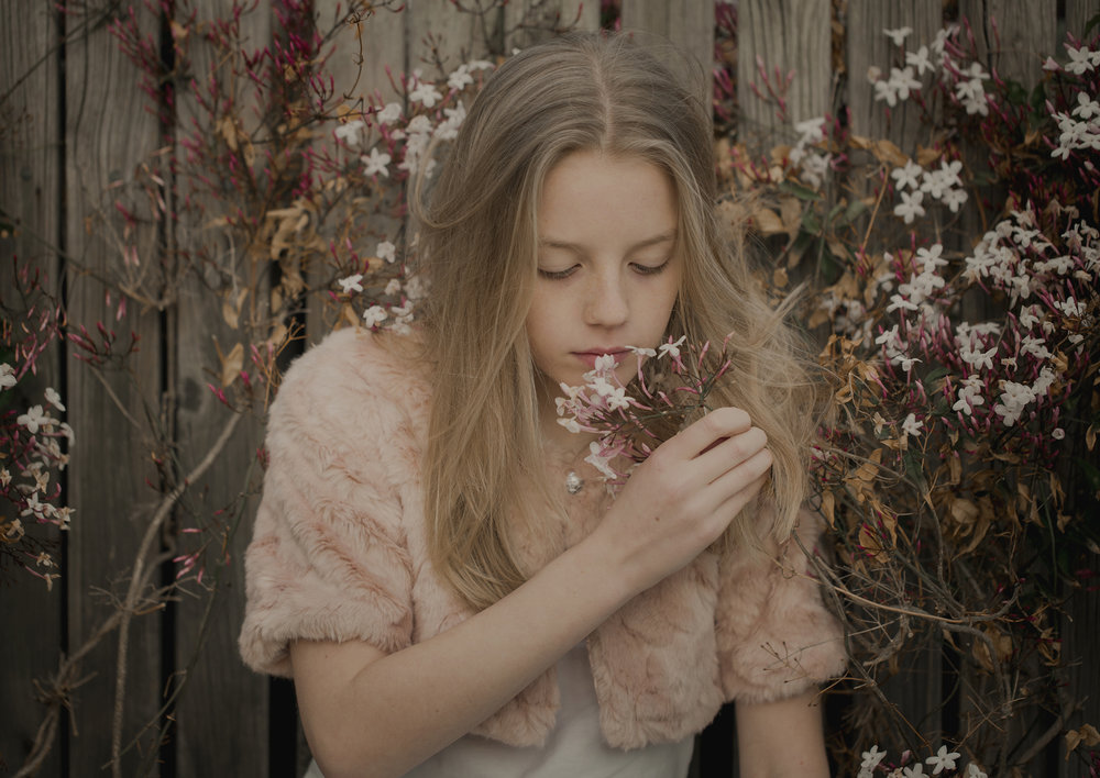Teenage girl smelling the sweet scent of jasmine!