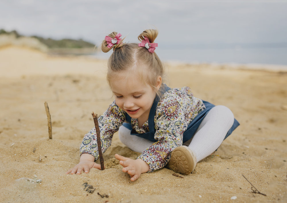 Toddler playing in the sand at the beach