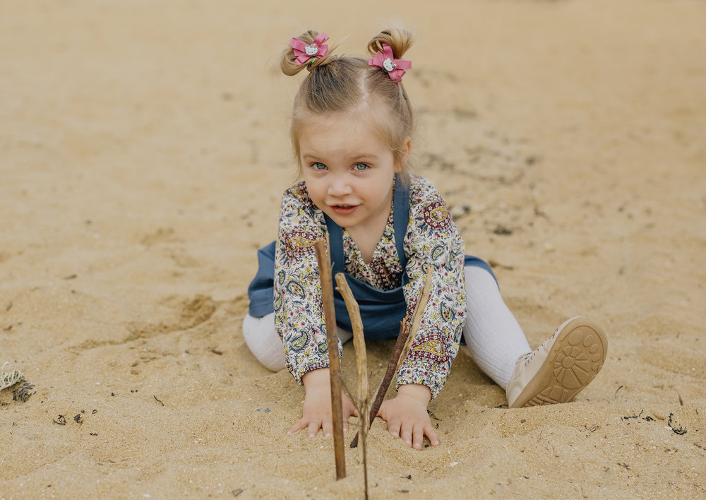 Natural photos of a toddler playing in the sand
