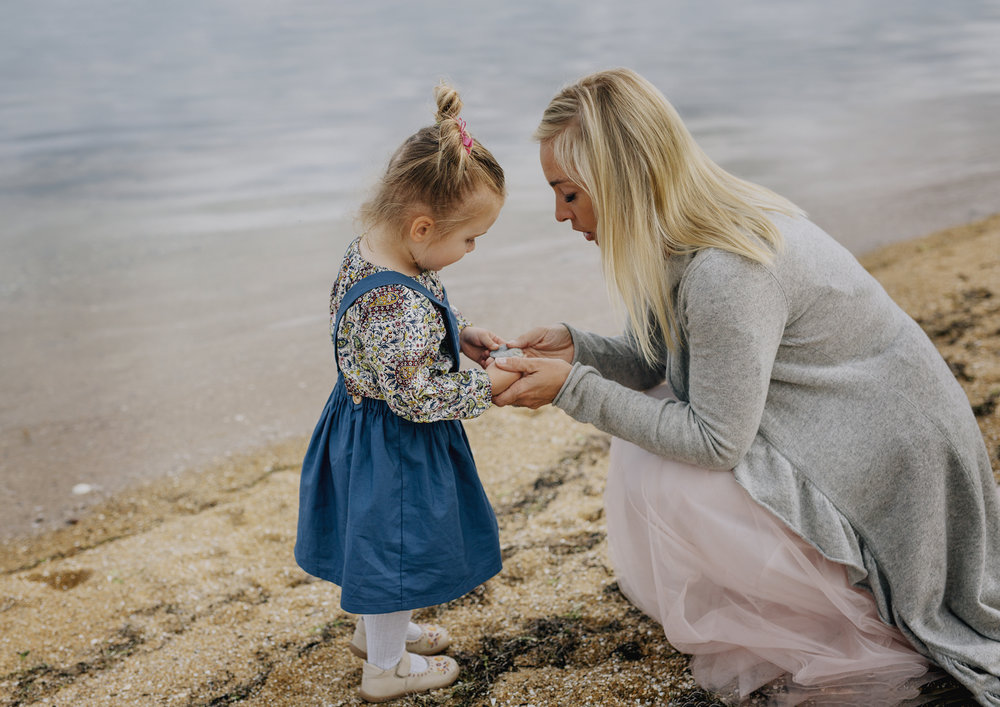 Child showing her Mother a sea shell
