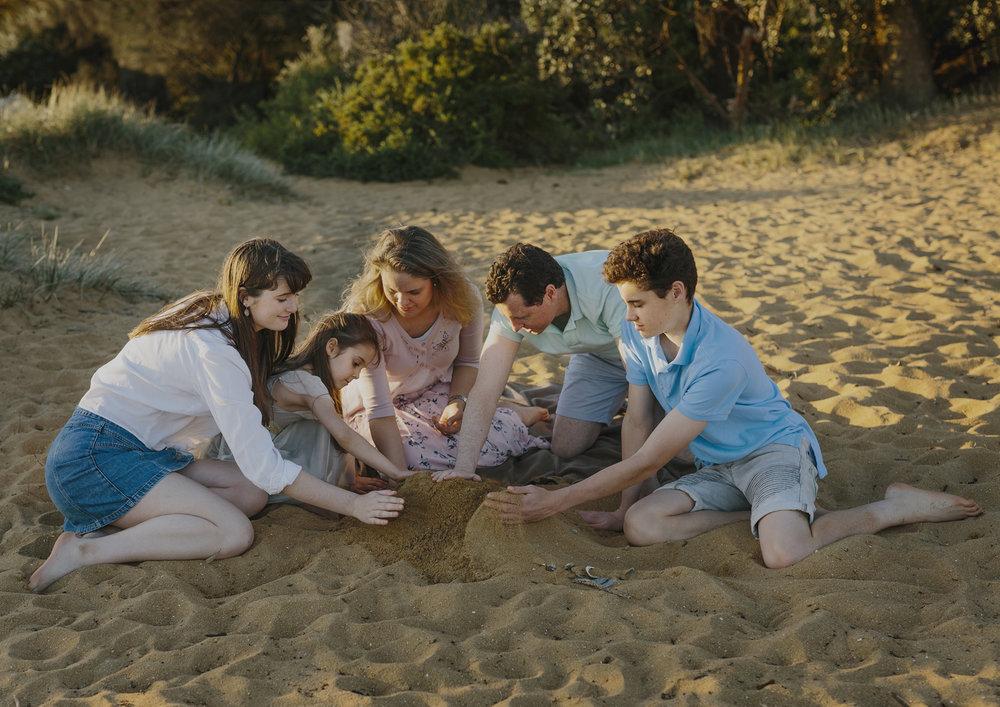 Family building sandcastles