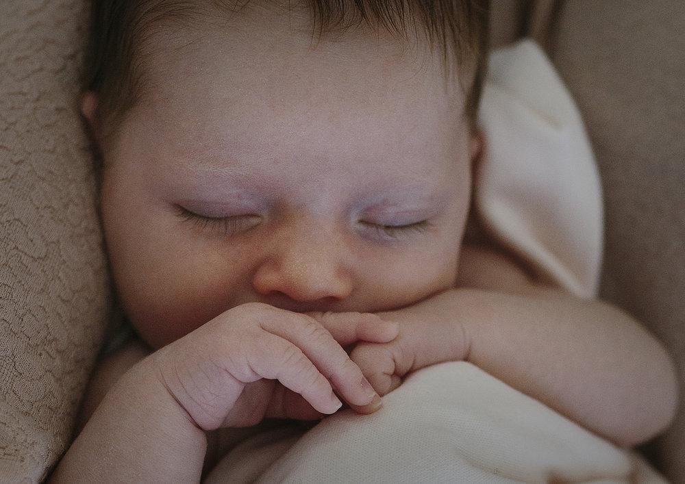 Newborn baby girl's tiny hands