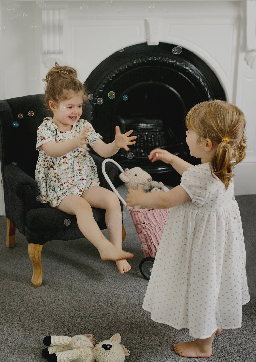 Sisters playing with bubbles!