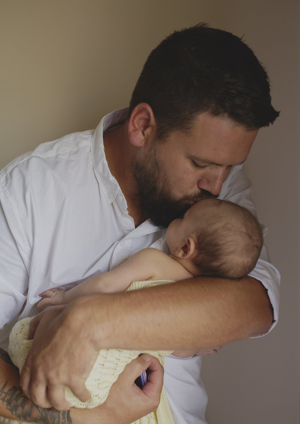 Daddy loves for his newborn baby girl