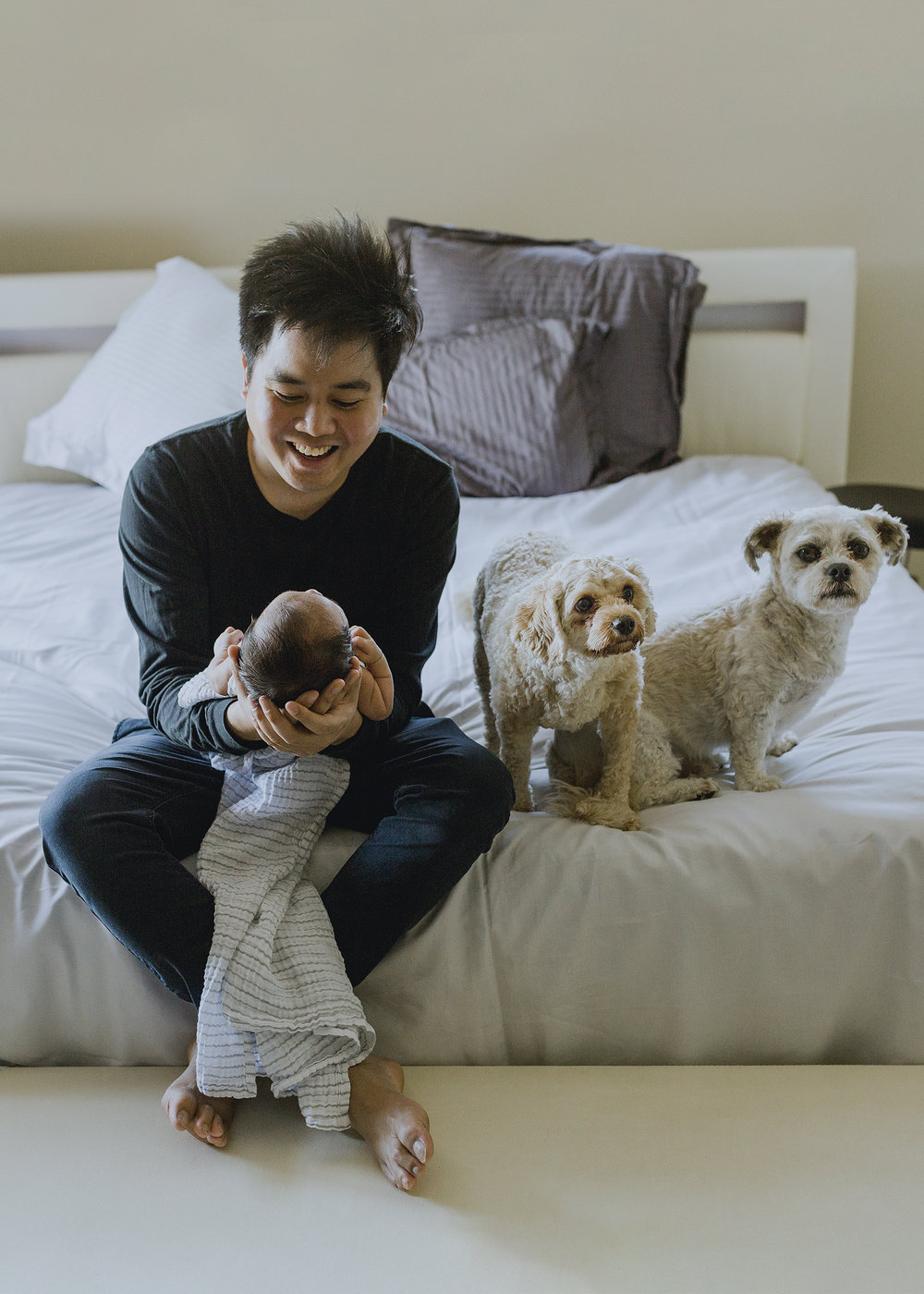 New Daddy besotted with his little family