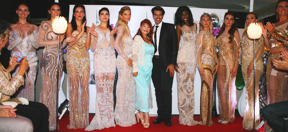 Designer Mohamad Homada of Kuwait with his models