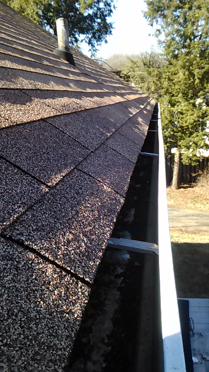 Image of a clean gutter after Charlottesville Lawn Care crews inspected and cleaned the gutter from the roof