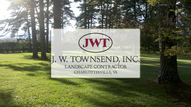 Image of JW Towsend's Logo in front of beautiful trees by Charlottesville Lawn Care along with Christian's Lawn Care.