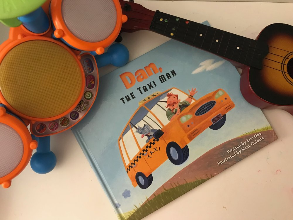 """""""Dan, Dan the Taxi Man... Going to the show and picking up the band... climb inside while you still can, with Dan 'BEEP, BEEP'The Taxi Man"""" So begins this book filled with musical sounds, chants and rhymes your kids will love to sing along with as you read.  After reading (or singing) this book, grab your own musical instruments and make your own band. Dancing in the kitchen, may ensue... But the kids in your life are sure to have fun!    Find Dan the Taxi Man Here"""