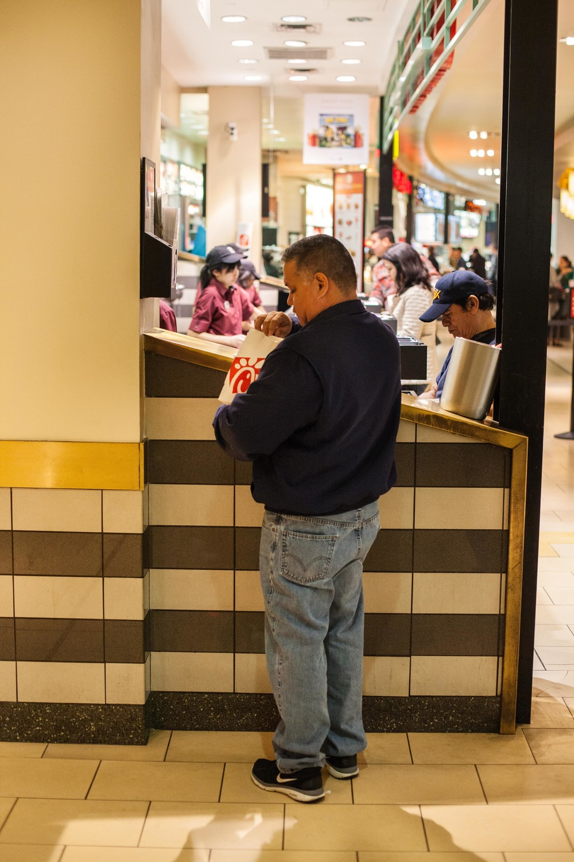 a man checks his chick-fil-a.jpg