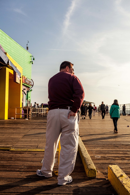 a man leans against a post.jpg